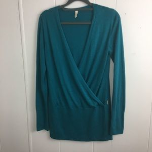Lucy size Sp color blue green sweater.